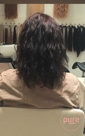 hairextensions met krullen